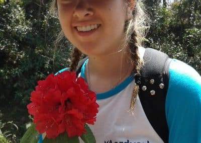 gap year program visiting nepal holding flower