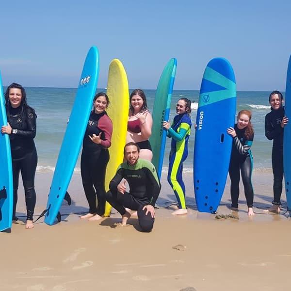 surfing in Tel Aviv Beach Catching waves