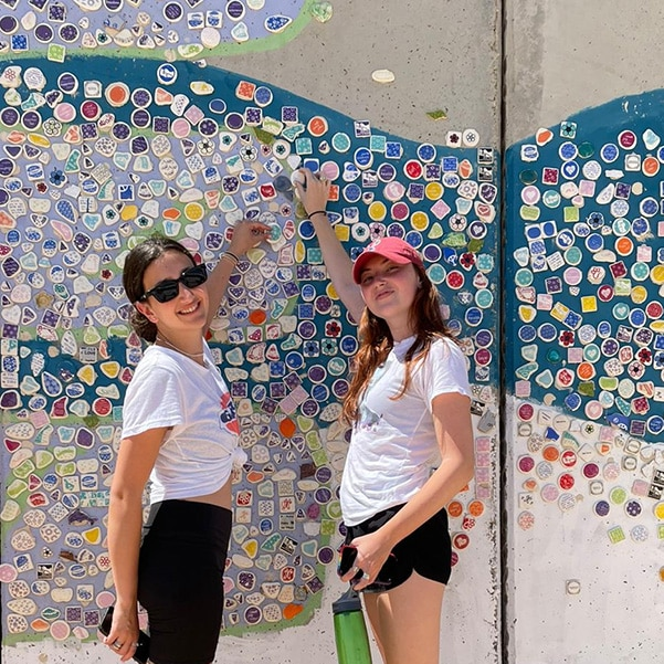 Colorful mosaic pieces, which were then attached to the security wall