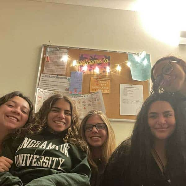Hannah, noa, esther, nicole, and amira spending some quality time in their apartment
